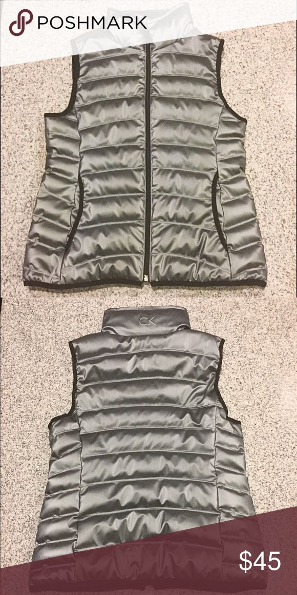Calvin Klein Metallic Vest NWOT This is a size small Calvin Klein metallic vest. It is a bit too big for me, so I am selling it. It is in perfect condition. If you have any questions about this piece, feel free to ask. Calvin Klein Jackets & Coats Vests