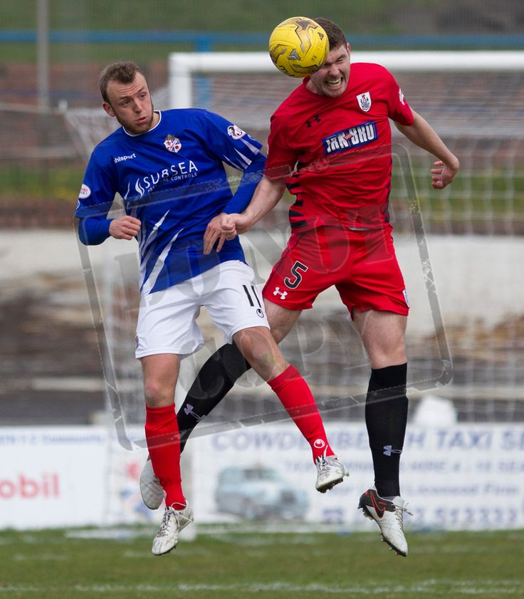 Queen's Park's Ryan McGeever wins the header during the SPFL League One play-off game between Cowdenbeath and Queen's Park.