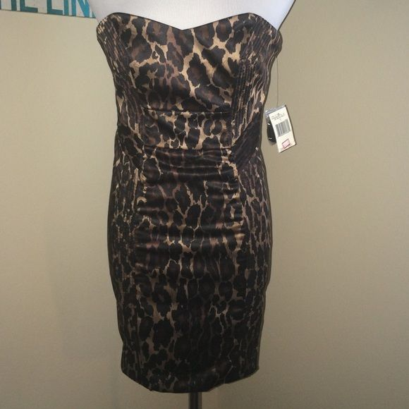 HP SALE!!NWT GUESS dress ShIp is discounted until 9:20! NWT. Does not fit my dress form(will add measurements of requested). Size 1. Very beautiful cheetah print. Guess Dresses Mini