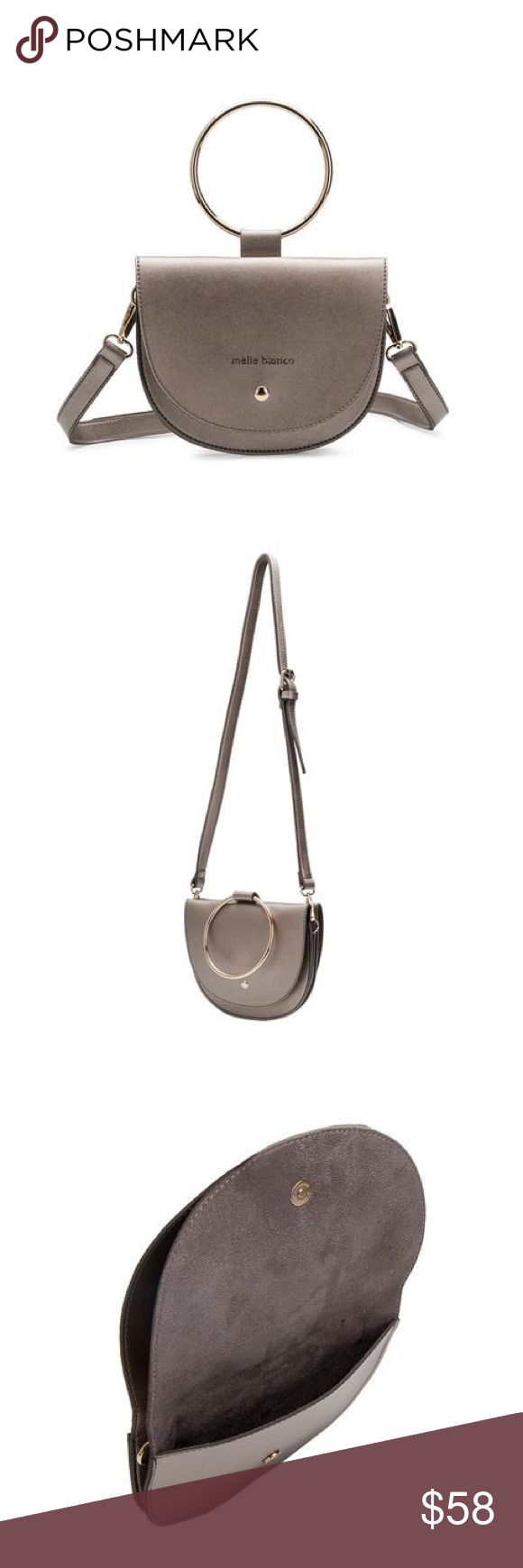 "Premium vegan leather handbag Premium vegan leather Melie Bianco crossbody handbag.  Front flap magnetic clasp closure. Removebable crossbody strap included - wear it by the ring only if wanted! Fits up to an iPhone 7 plus. Dimensions 8"" L x 5"" W x 6.2"" H. 2 colors - GREY and GOLD. Melie Bianco Bags Crossbody Bags"