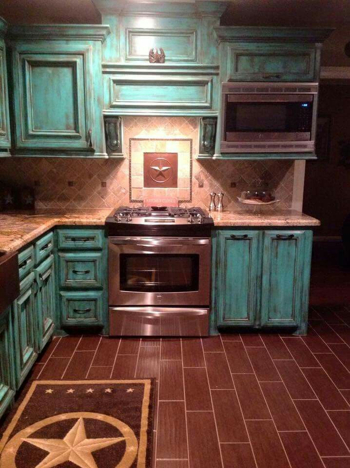 Distinctly Different Design featuring Turquoise Hued Cabinets with a very desirable aged look.