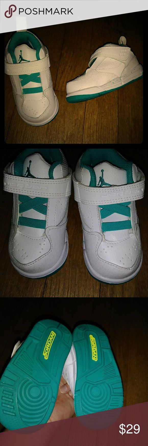 Toddler Jordans Size 5c New never worn but did try on my daughter.. please check pic 4 for spot on top of one shoe. I think it is where my daughter tried to put it on. Pretty sure it will come off I just didn't want to mess with it Jordan Shoes