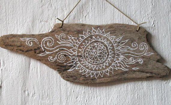 This is a freehand painting of my own ethnic inspired sun design on a particularly lovely piece of driftwood I found. I was waiting to think of a