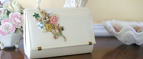 repurposed purse  ~decorate with the costume jewelry you normal pass by @ yard sales and thrift stores.
