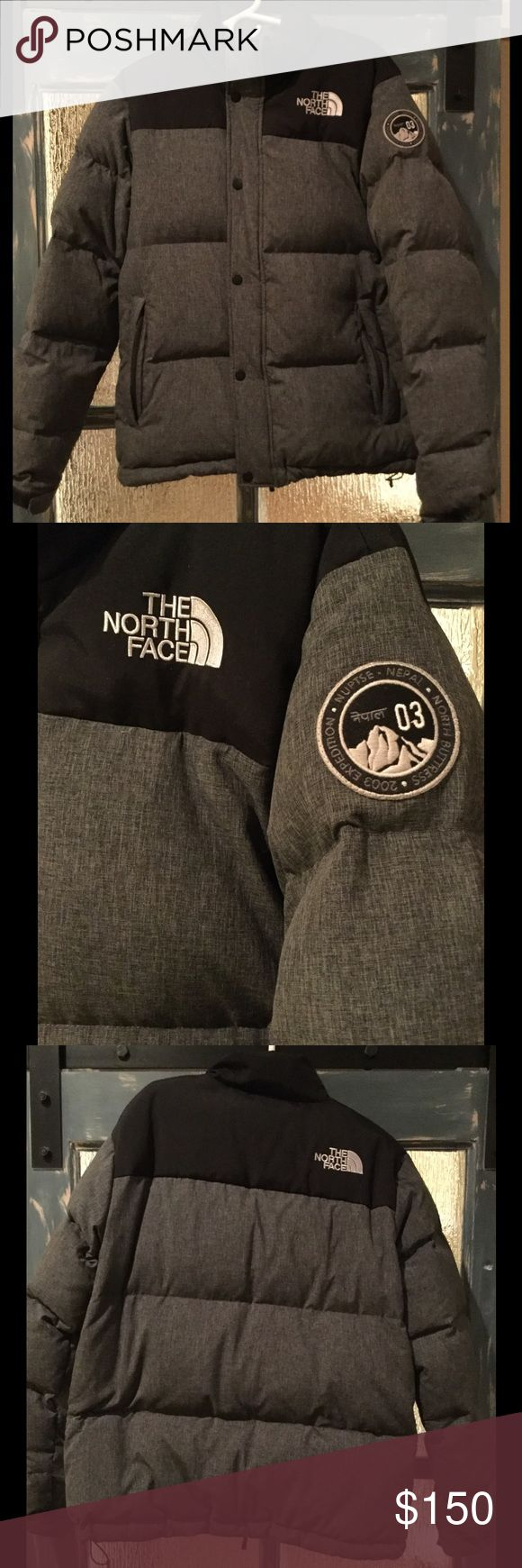 The North Face Nuptse jacket Gray/Black. Medium The North Face Nuptse Jacket. Size Medium. Down filled for super warmth. It's a great Jacket but I just don't wear it very often The North Face Jackets & Coats Puffers