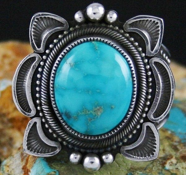 Navajo jeweler Sammie Kescoli Begay has created this classic ring entirely from hand rolled and hammered sterling silver ingot. The shank is heavy with fine stamping signature to the artist. Fans flair from the outer edges of the ring face with three large droplets at the top and bottom. | eBay!