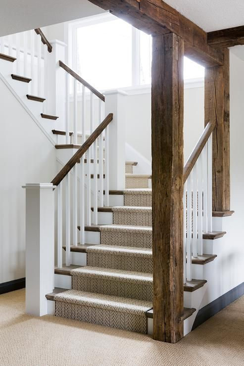 Rustic Wood Beams Accent A White Staircase Contrasted With