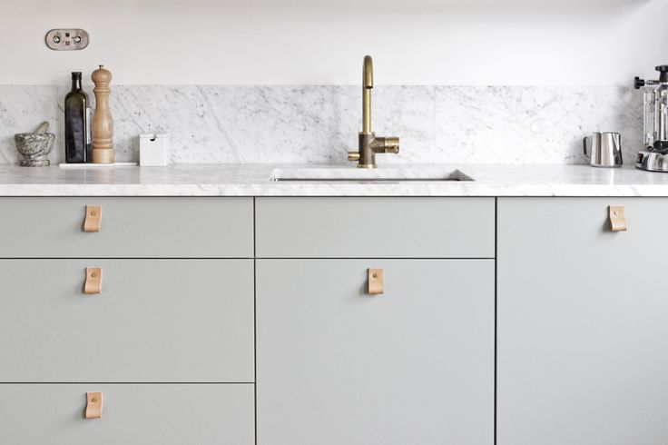 our kitchen - green fronts, marble counter top, brass tap from tapwell and leather handles