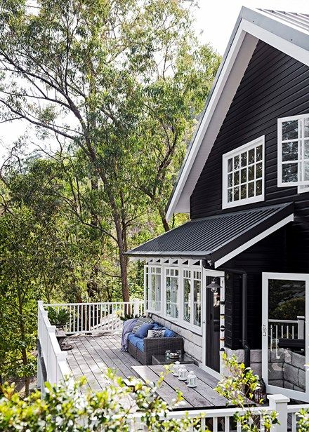 With its gable roof and all-wood exterior, TV host Tara Dennis's family home sits beautifully with its rugged natural surrounds | Home Beautiful Magazine Australia