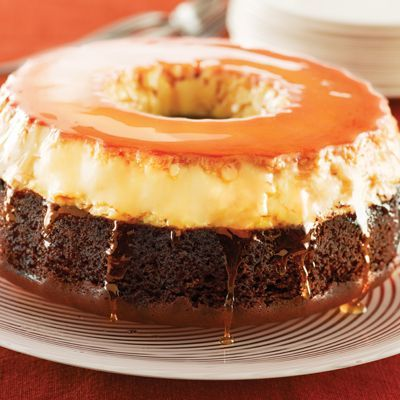 Flan Cake Ingredients:Nonstick cooking spray,1 cup granulated sugar,8 large egg yolks,1 can (14 oz) NESTLÉ LA LECHERA Sweetened Condensed Milk,1 can (12 fluid oz) NESTLÉ® CARNATION® Evaporated Milk,1 package (18.25 oz) devil's food cake mix. Directions: Pre heat oven to 350° F.Move oven rack to lowest position.Spray a 10-inch bundt pan with nonstick cooking spray. Place a roasting pan half filled with water in the oven...jlc