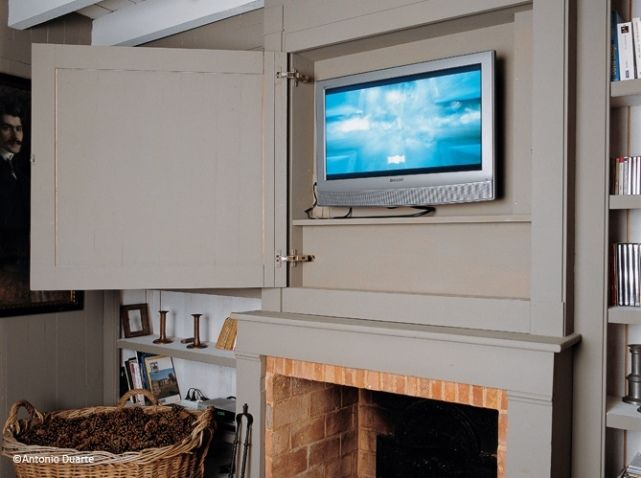 Instead of TV...both sides next to TV to cover breaker box but have even shelving