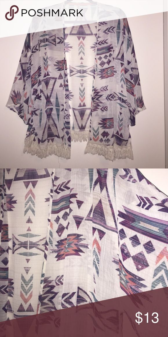 Aztec print sheer kimono Aztec print purple, coral, and turquoise sheer kimono. The little fringe on the bottom is the perfect touch. Xhilaration Sweaters Cardigans