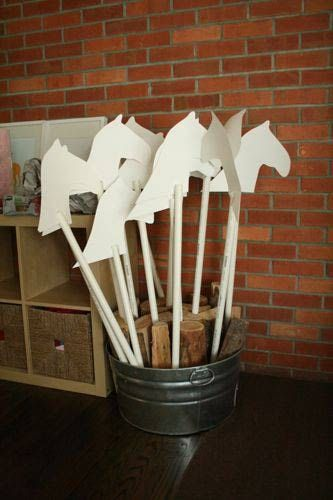 Here's a simple cowboy party idea: make each child a hobby horse from posterboard and PVC pipes, have them decorate them with craft supplies, then send them home with the kids as party favors.
