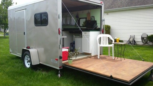 woman converts cargo trailer to stealth micro camper instant patio 600x337   Woman Converts Cargo Trailer into Stealthy and Cozy Off Grid RV