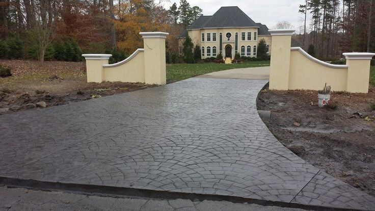 Stamped concrete driveway swale, pattern European Cobble Fan