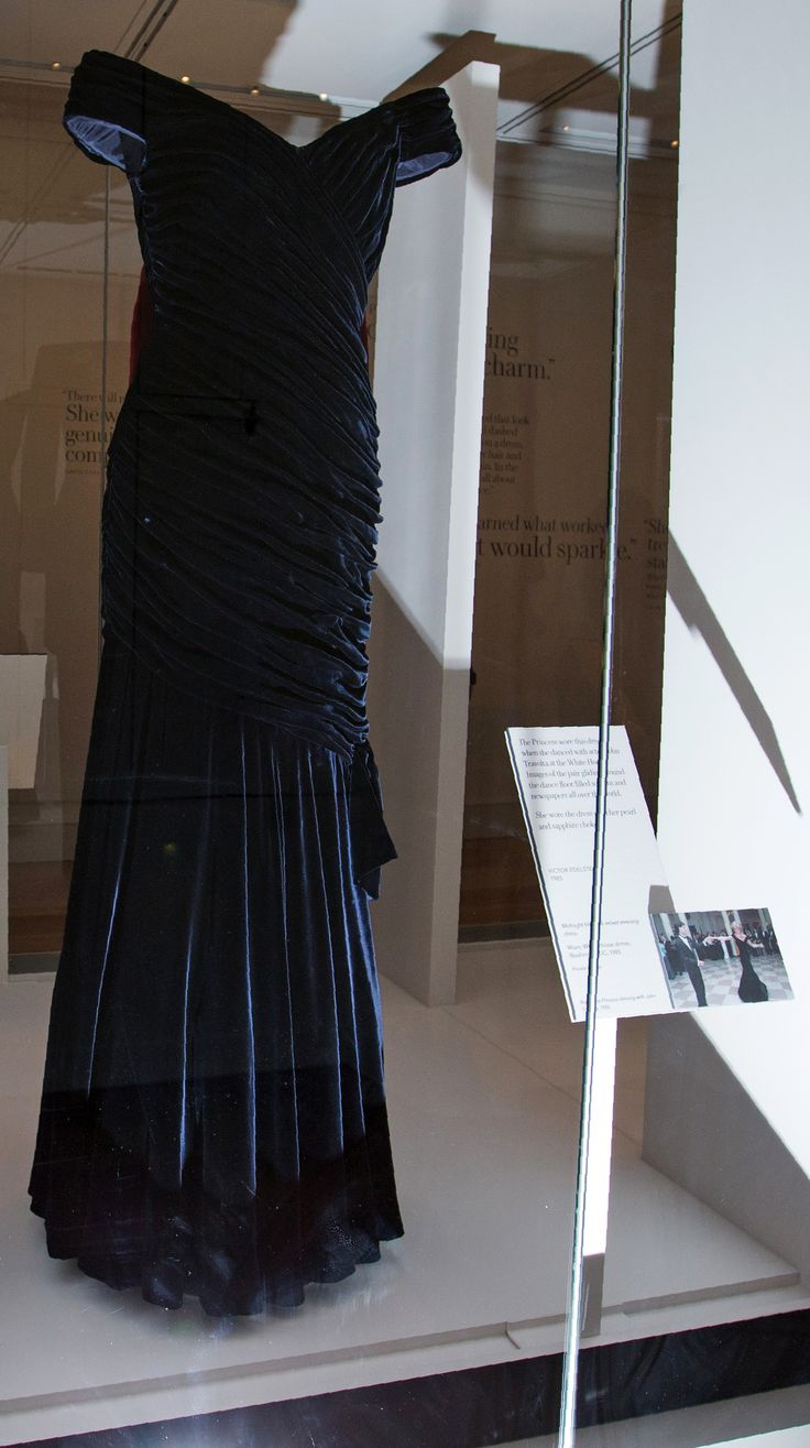 TOPSHOT - A dress by designer Victor Edelstein, and worn by Britain's Diana, Princess of Wales at the State Dinner at the White House in Washington in 1985, is pictured during a press preview of the forthcoming exhibition entitled 'Diana: Her Fashion Story', at Kensington Palace in London on February 22, 2017. Glittering gowns, elegant suits and bold mini-dresses worn by the late Princess Diana will go on show from Friday on the 20th anniversary of her death in a unique exhibition charting…