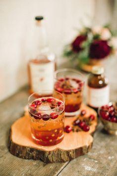 Bourbon and cranberries: http://www.stylemepretty.com/2015/01/11/10-winter-wedding-drink-ideas/