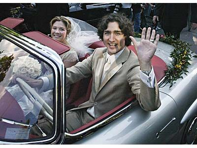 Justin Trudeau, son of the late prime minister Pierre Trudeau, leaves with his new bride Sophie Gregoire in his father's 1959 Mercedes 300 SEL after their marriage ceremony in Montreal, Saturday, May 28, 2005.