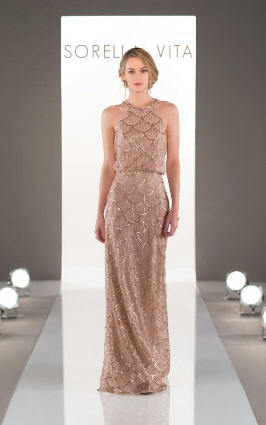 A modern, high neckline complements a stunning, artful pattern in this Nouveau Sequin bridesmaid dress.