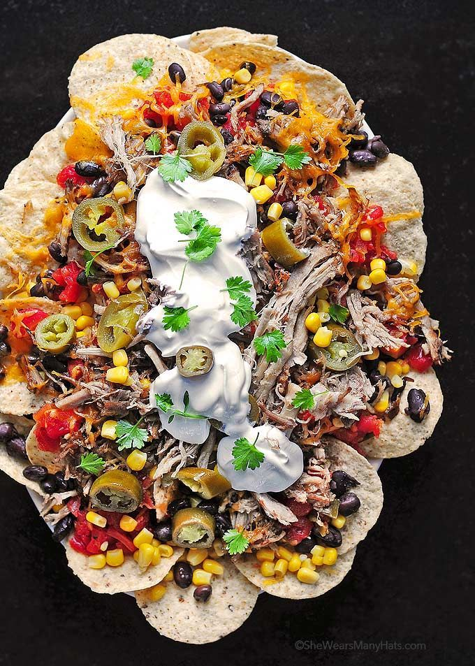 Loaded Pulled Pork Nachos | This would make a great choice for a potluck or sleep over. It's filling and flavorful. Some of us dial back on the jalapenos, but if you crave the heat, you can certainly pile on the peppers. @wearsmanyhats