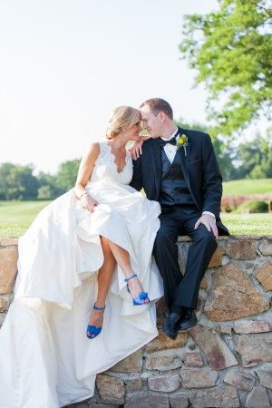 What a pretty wedding dress, with blue shoes : )