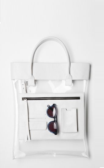 (3way pocket bag-clean by Low Classic) Tote Bag: A large open-topped bag with two parallel handles that emerge from the sides of its pouch. It is used for carrying a number of items. FMM1B1 Bernice Chia Task1