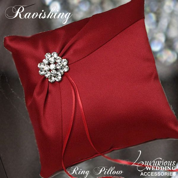 The Ravishing Red Ring Pillow from Luxurious Wedding Accessories features a soft matte crimson satin. A second layer of satin displays the sparkling rhinestone cluster brooch. Match with our Ravishing Red Silk Brooch Bouquet.