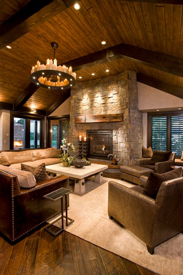 Great hearth room! Love the ceilings and double sided fireplace.