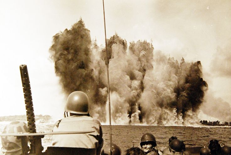 Battle of Peleliu, September-November 1944. Underwater Demolition Teams. A massive wall rises from the water off Peleliu as 8,000 pounds of tetrytel explode. Photograph released August 31, 1945. Official U.S. Navy Photograph, now in the collections of the National Archives.