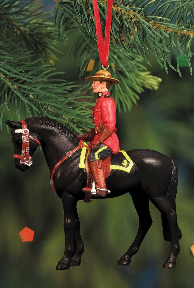 RCMP Musical Ride Ornament features a RCMP officer and his mount in ceremonial dress. This ornament represents the Royal Canadian Mounted Police's Musical Ride.