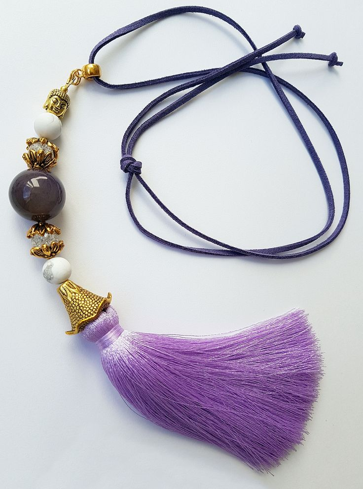 'Purple Candy' Unique Necklace 'Purple Candy' for Women Made out of Mate Howlite (10 mm), Mountain Crystal (10 mm), Agate (20 mm) beads, leather strip and silk tassel This is a great gift to the one You love! Necklace comes in original 'Buddha Touch' box