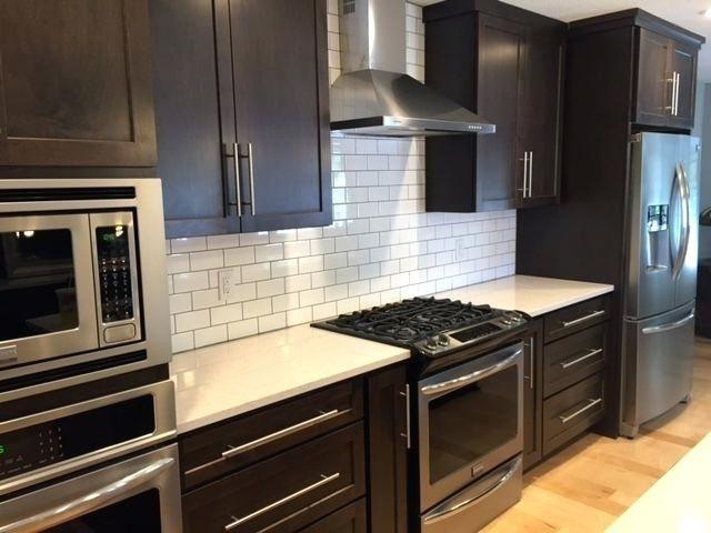 subway tile kitchen dark cabinets dark shaker cabi…