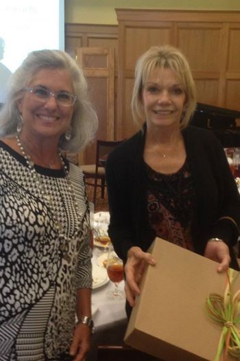 Melanie Mitchell of Starkville Properties presents Becky Gunter with the MARPAC door prize at the REALTOR® Luncheon today!