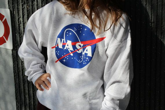 The same basic official Nasa meatball logo on a heather gray pullover. This sweatshirt is extremely comfortable and versatile. Pictured is an Adult