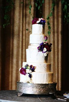 Details        cake shape: round or oval      Color: pink, white/ivory      decorations: flowers      Real Weddings: Real Weddings      Wedding Style: classic, glamorous, Formal      toppers: flowers