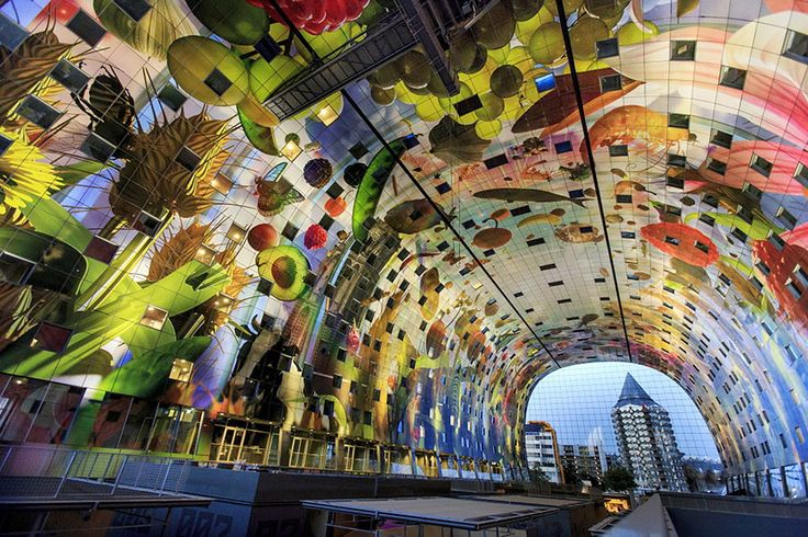 A new market hall has opened its doors in Rotterdam in the Netherlands, and it's turning quite a few heads. The enormous Markthal Rotterdam, a curiously elongated horseshoe of a building, has a 36,000 square foot mural covering its rounded ceiling.