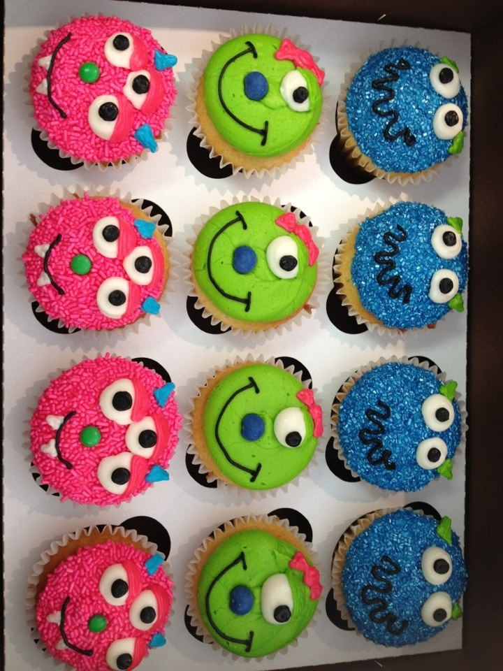 pink and blue cupcakes with some small googly eyes and some big eyes  eyes can be made with sliced marshmallows   or buy edible googly eyes teeth ends of candy corn  black gel icing