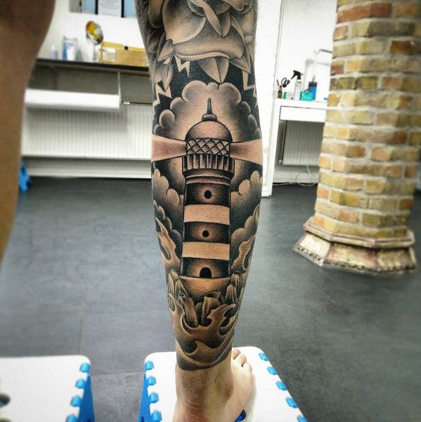 Black and Grey Ink Lighthouse Tattoo by Art of Ink