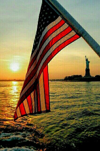 "New York Sunset...""There's a lady who stands in a harbor for what we believe..."" Where the Stars & Stripes and the Eagle Fly, Aaron Tippin"