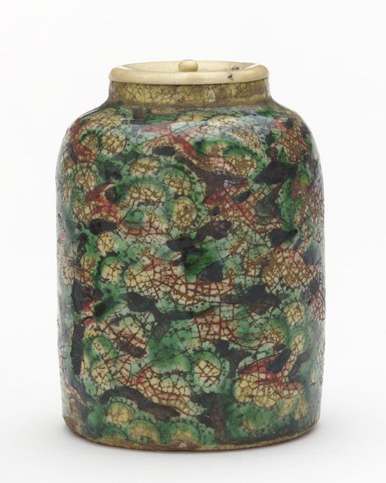 Powdered tea container with design of phoenix and clouds mid-19th century Kensai (Ida Kichiroku) , (Japanese, 1793-1861) Edo period. Brown clay; white slip, enamels, and iron pigment under transparent lead glaze. H: 8.1 W: 6.2 cm Japan