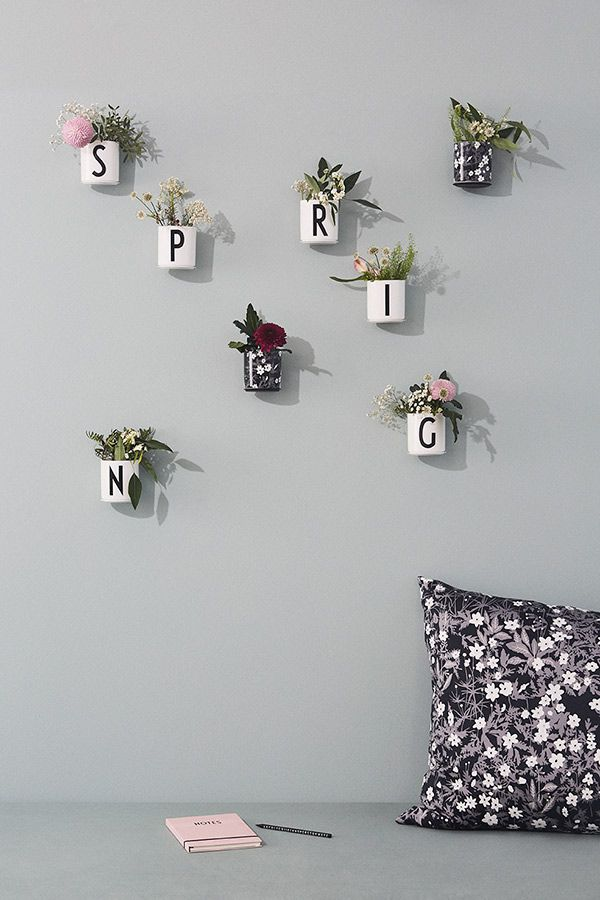 Spring on the living room wall. Small spring flower bouquets in our AJ Vintage ABC and Flowers by AJ porcelain cups. The cups are mounted on the wall with Cup Up wall mount.