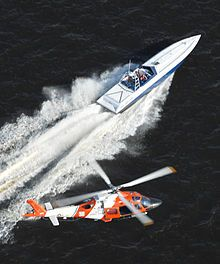 A helicopter from the U.S. Coast Guard's Helicopter Interdiction Tactical Squadron pursues a go-fast boat during training.