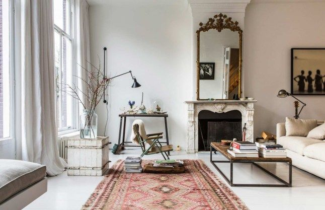 great mirror over fireplace, very very nice rug, floor to ceiling windows, comfy couch &  possibly a chaise or daybed by window (at least that's what I would put there)