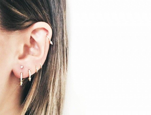 New York–based Danielle Bernstein of We Wore What is a must-follow if you're on the market for piercing inspiration. She regularly displays her ear party situation, which typically includes a cool mix of studs and hoops, sometimes throwing in an oversize earring or two.
