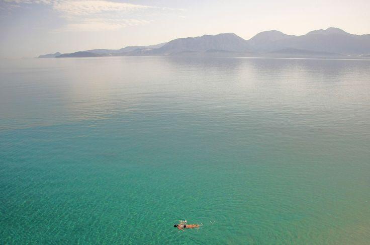 Swimming in the Cretan Sea green by Adam Konieczny on 500px