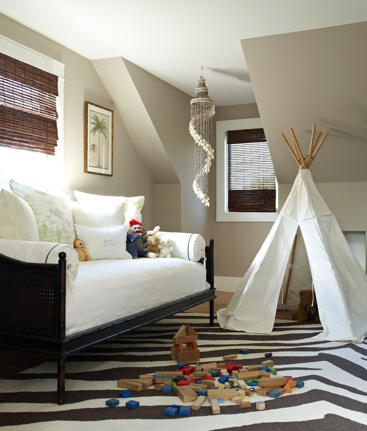 Kid's playroom with daybed, teepee, and zebra print rug; Bella Mancini Design