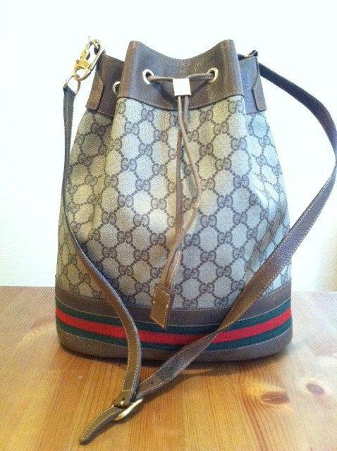 Vintage Authentic Drawstring GUCCI Handbag with Logo