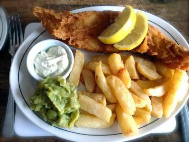 Deep-fried fish in a crispy batter with fat golden chips is still one of Britain and Ireland's favorite meals. The love for them ranks alongside roast beef and Yorkshire puddings and chicken tikka masala, which was recently nominated to be the English national dish.