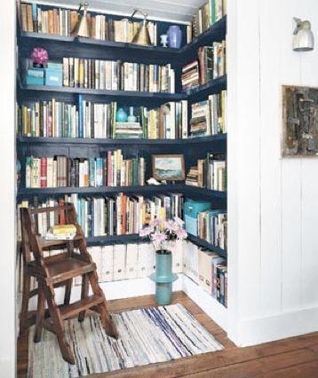 Real Simple / Nikolas Koenig {closet - turned - library with black shelves}