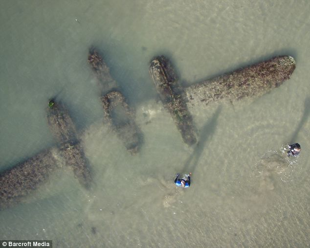 Buried by a Welsh beach for 60 years, the World War II fighter that has emerged from the seas